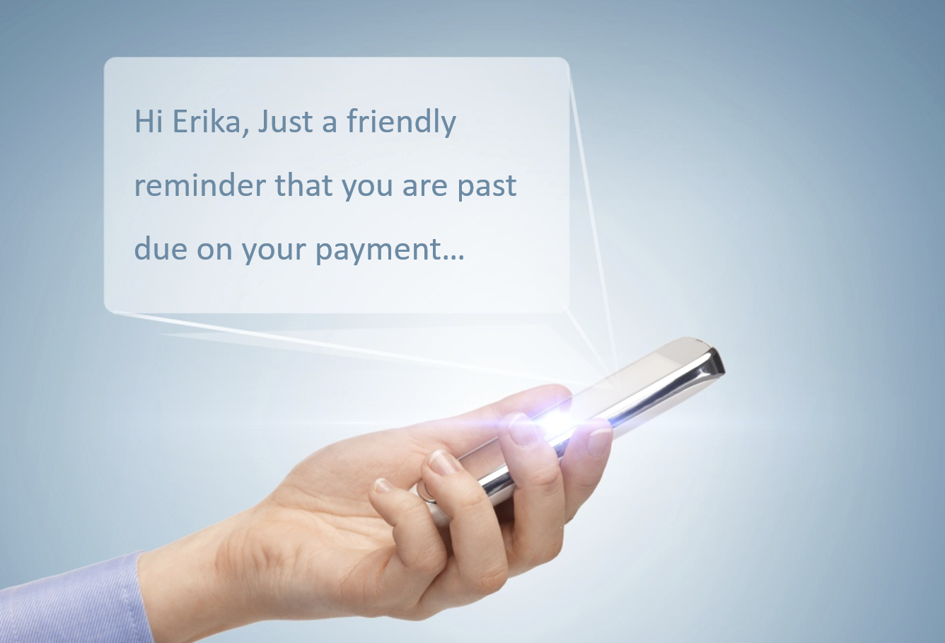 Woman's hand holding a smartphone with a personalised message bubble telling her she is past due on payment