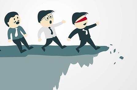 3 cartoon business men walking towards the edge of a cliff and the front one is blindfolded